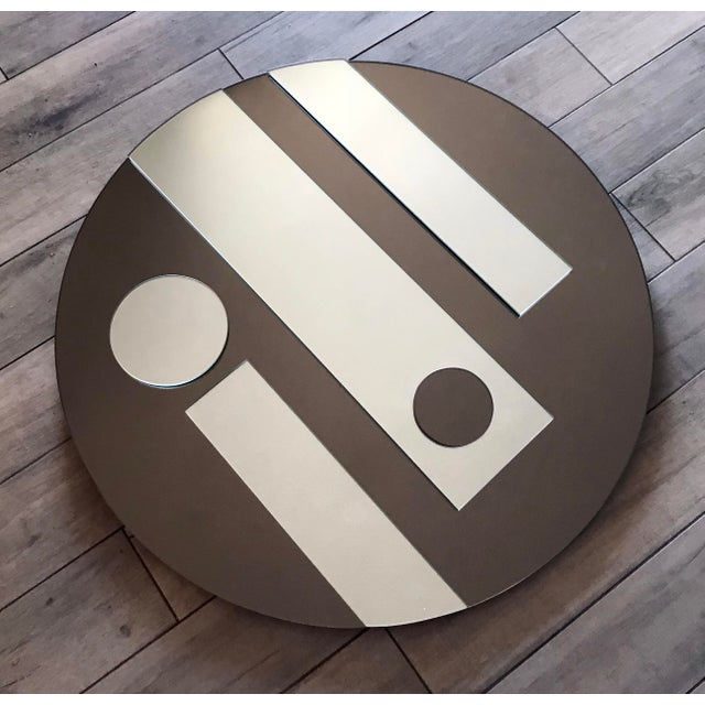 An absolutely stunning and increasingly rare op art mirror by iconic designer Hal Bienenfeld. This mirror has tone on tone...