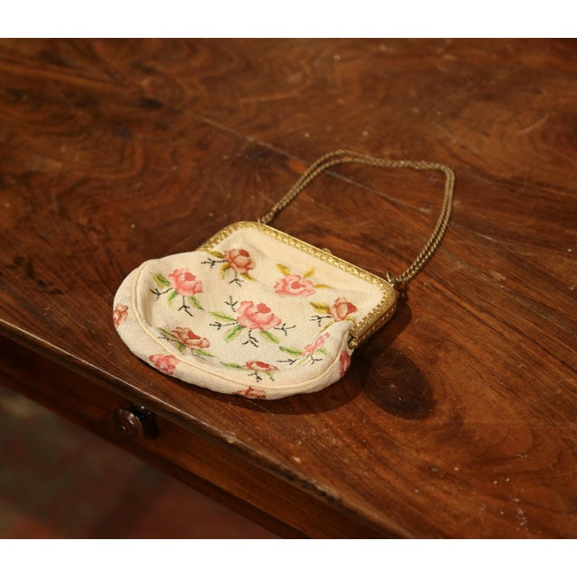 Elegant antique purse from France; hand woven circa 1860, the small colorful purse is handmade using needlepoint...