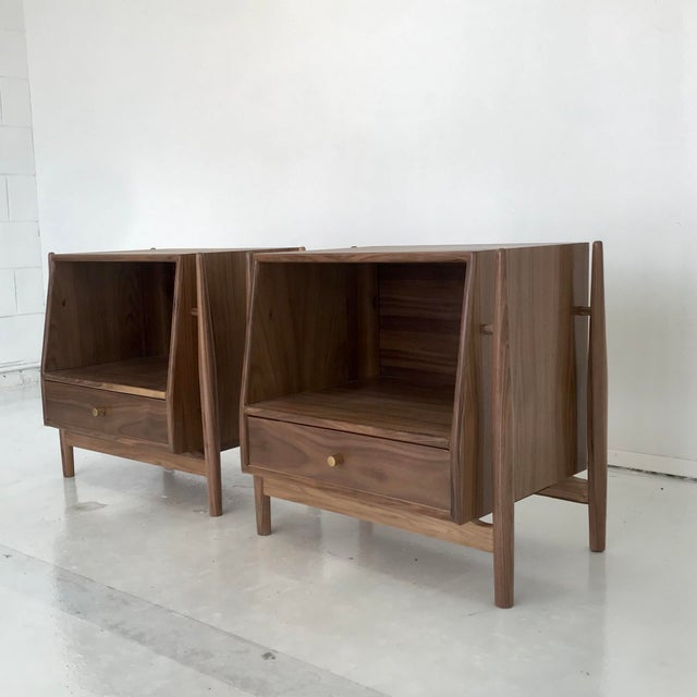 Contemporary pair of nightstands in the style of Kipp Stewart , handcrafted in solid and walnut veneer . This pair shows...