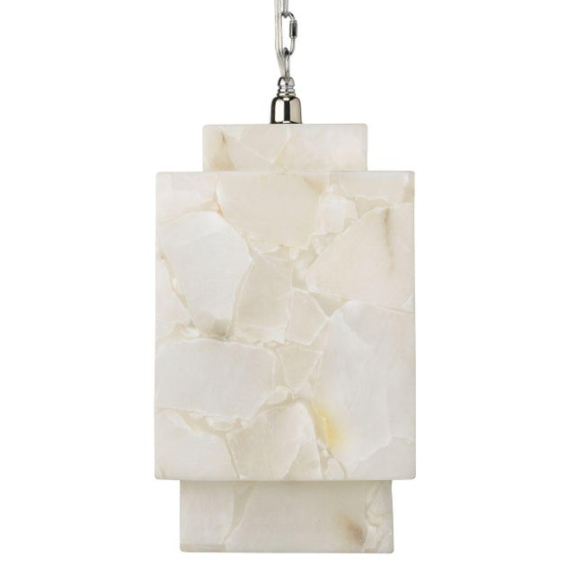 This unique alabaster pendant has strong cubic lines that float in it's alabaster white glow.