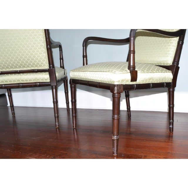 Pair of vintage, faux bamboo fine side chairs, attributable to the Hickory Chair Company. Each chair has some scuffing and...