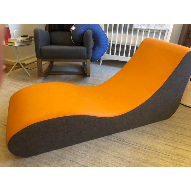 Verpan Welle 4 Lounge Chair, designed by Verner Panton in 1969. In orange parotega vegan leather with brown fabric sides....