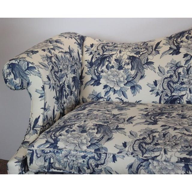 Dramatic Chippendale style sofa with a camel-back form and a serpentine bow front edge. Features Ralph Lauren toile...
