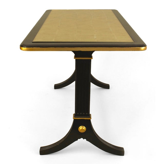French 1940s ebonized and gilt trimmed rectangular coffee table with pedestal sides connected with a stretcher and...