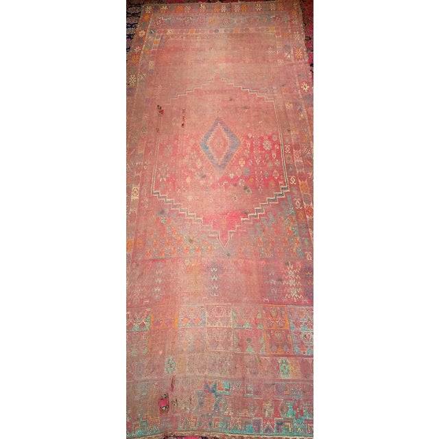 A beautiful Moroccan Rabat tribal carpet in a geometric design. Astonishing colors in the field and the border. A rare...