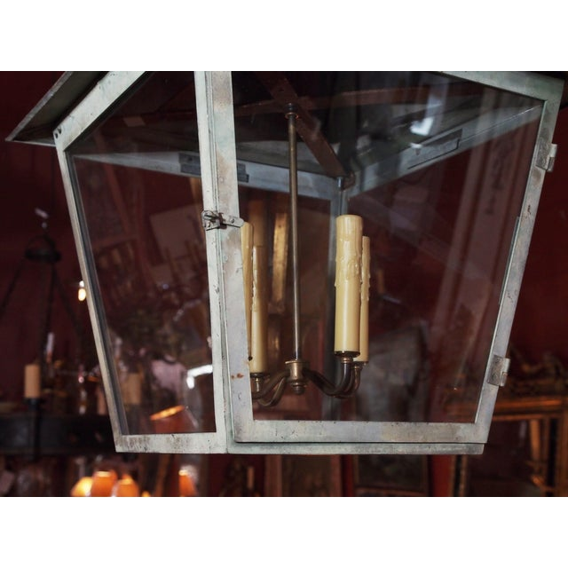 19th Century copper French lantern. Due to age copper turned to a beautiful green patina. 4 lights cluster. US wired. Each...