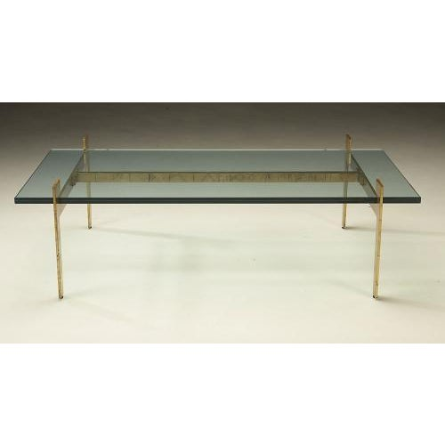 Shown in antiqued gold leaf with one inch thick glass top. The Beyrouth Coffee table by Studio Van den Akker is also...