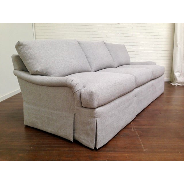 SHOWROOM SAMPLE. A comfortable, large scale custom sofa with a skirt from deck and reversible, loose seat and back...