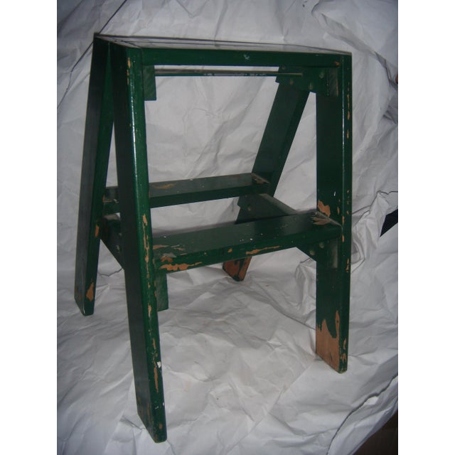 A nice old green step stool. Great for a country cabin.