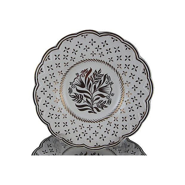 A set of six scallop edged plates, gilded floral, raised molded rims. Circa 1940. Stamped and impressed with the Wedgwood...