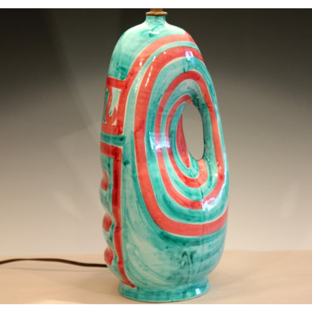 "Vintage hand made Italian pottery lamp with stark red geometric design on a turquoise ground, circa 1960's. 25"" high, 15""..."