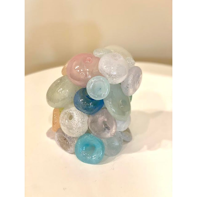 This is a fun and one of a kind blown glass art sculpture. It resembles a multitude of things ranging from bubbles or...