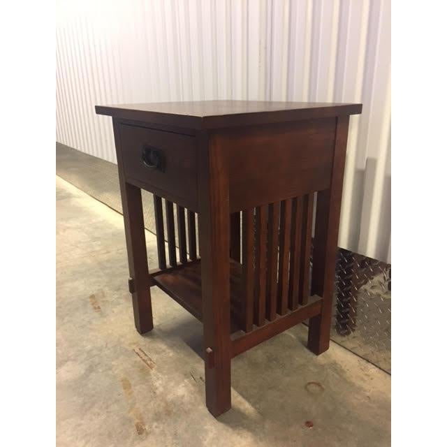 Solid wood Mission style night stand in excellent condition by Durham furniture, which is known for making high quality...