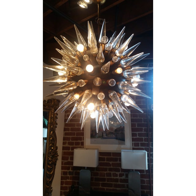Stunning Italian Sputnik Chandelier with a gunmetal base finish. Solid glass spikes supported on brass hardware. Round...