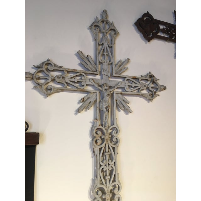 Antique French iron cross from mid to late 1800s. This cross is rare and is beautifully ornate. It is made of solid cast...