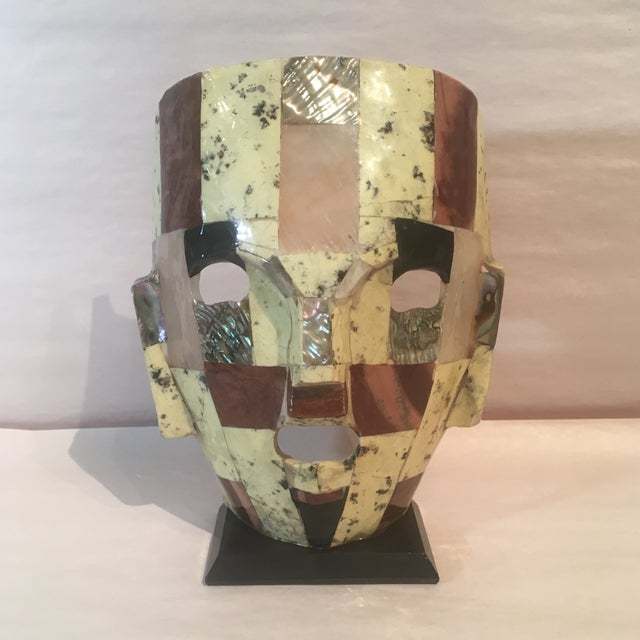 Fabulous mosaic mask with mother of pearl. This mid century piece would look great on any shelf, mantle or cabinet. It...