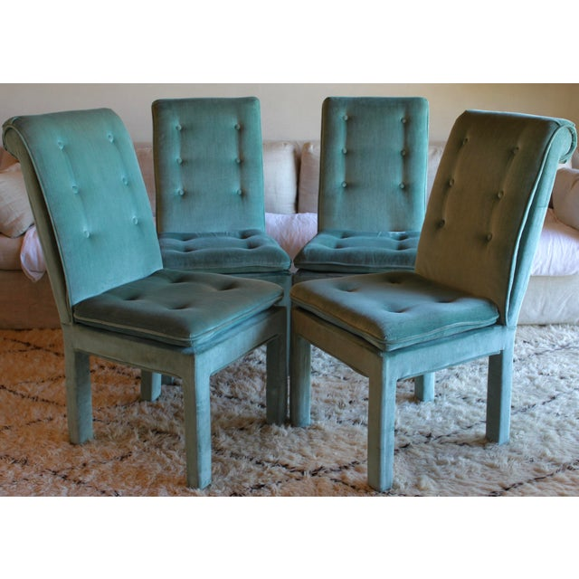 This delicious hue can be modern, playful, or refined. Vintage teal velvet Parsons dining chairs with button tufting and...