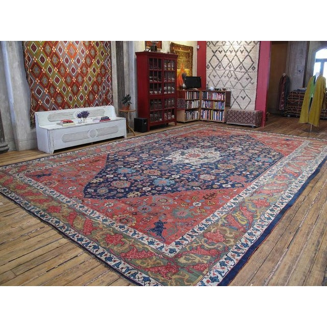 A very handsome antique Persian carpet from the Kurdish provinces of Western Iran. The design is well-known in the Bidjar...