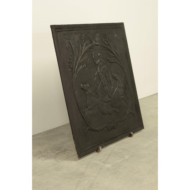 Beautifully detailed and square antique cast iron fireback. This fireback shows Poseidon standing on a big shell in...