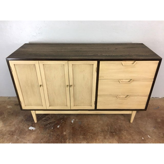 Unique, two-toned mid century modern credenza in a dark walnut stained oak cabinet with a off-white wash front....