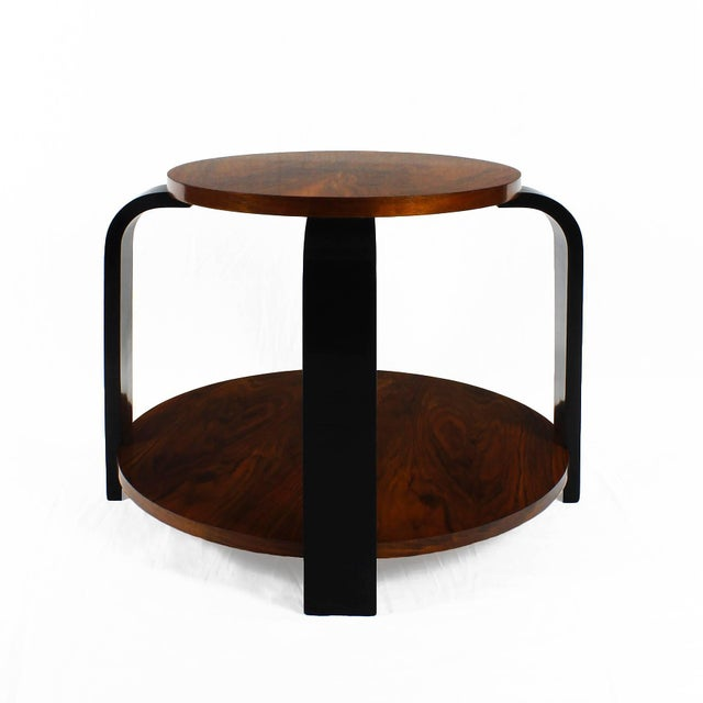 Art deco side table with four curved ebonized beech stands and two walnut veneer trays, French polish. France, circa 1930...