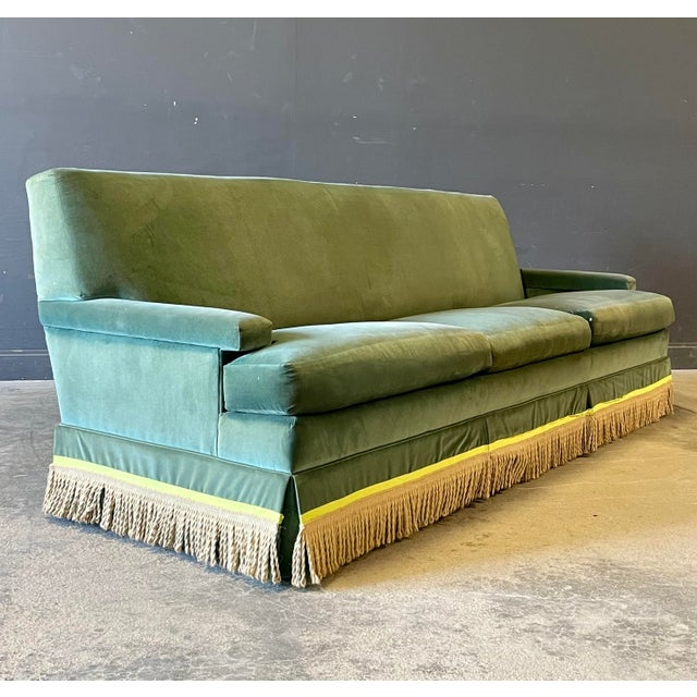 A truly outstanding sofa. Modern clean lines, down filled, high quality green velvet with a contrasting lime lined fringe....