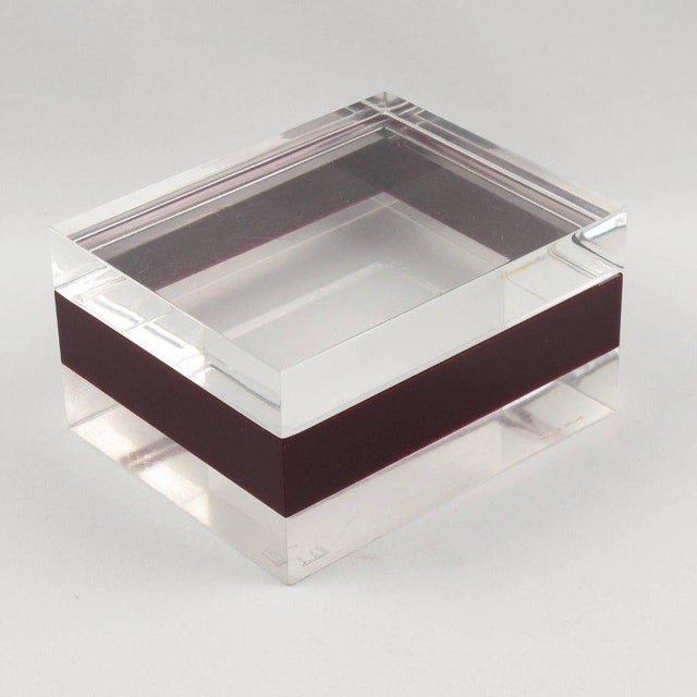 Rare Mid-Century modernist Lucite decorative box by Dunhill, England, circa 1970s. Crystal clear and cranberry red color,...