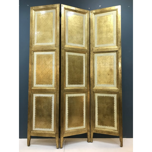 Rare giltwood room divider is in beautiful condition aside from a few nicks, with all original two way brass hinges....