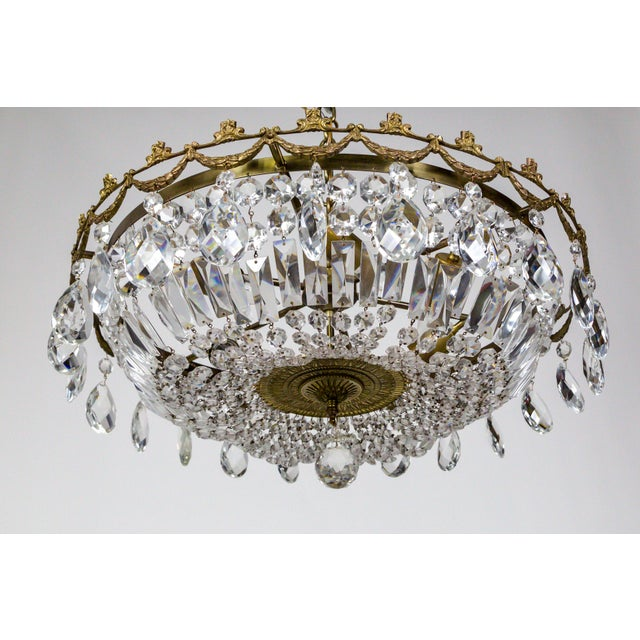 This Mid Century, American chandelier is wide, shallow, basket shape, made with swooping baguette and octagon crystal...