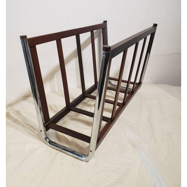Danish rosewood magazine rack done in clean lines and has chrome accents. Great for any room and multi functional, can...