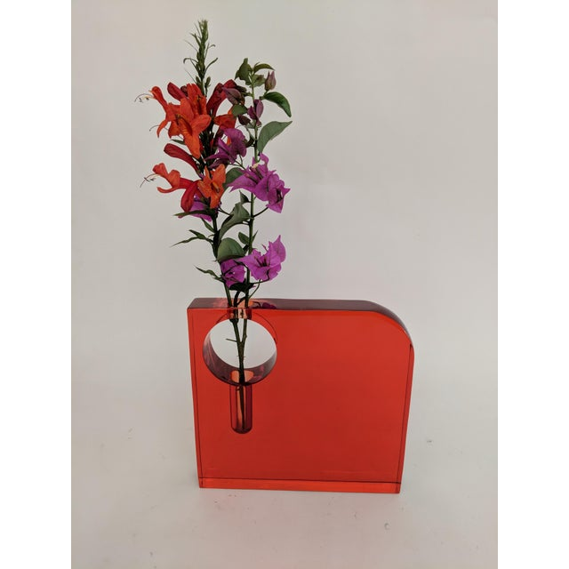 This bud vase is a total statement piece. The bold orange color and abstract design are a winning combination. Opening of...