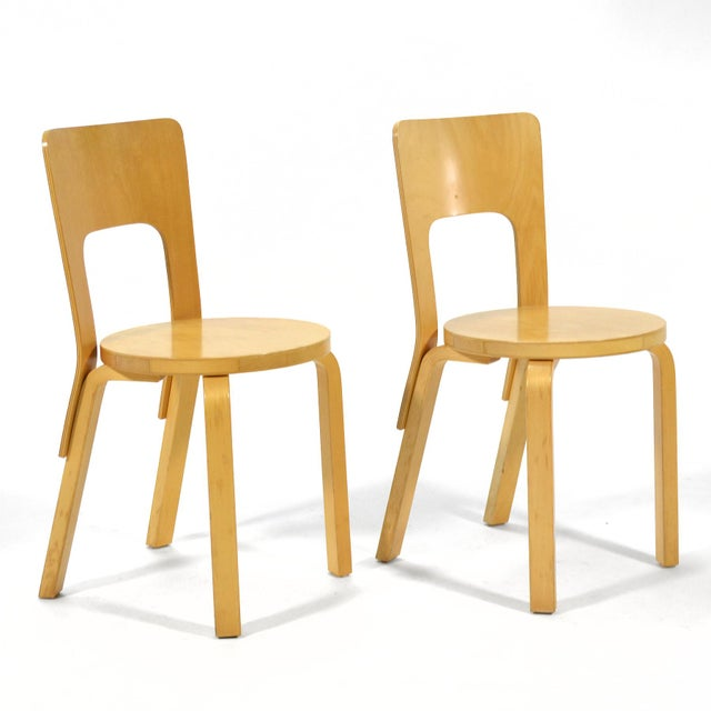 Next A lovely pair of Alver Aalto's model 66 chair. Produced by Artek, distributed by ICF.