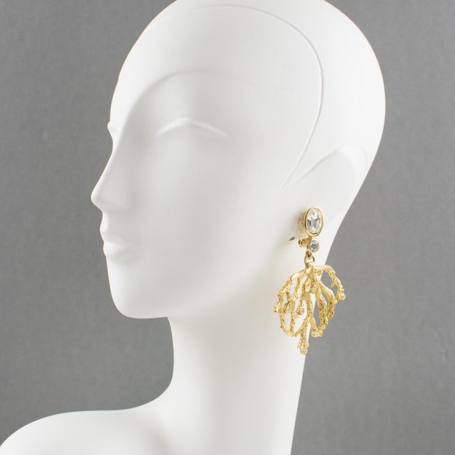 Fabulous Yves Saint Laurent Paris signed clip on earrings. Gilt metal dangling shape with hand-made feel textured pattern,...