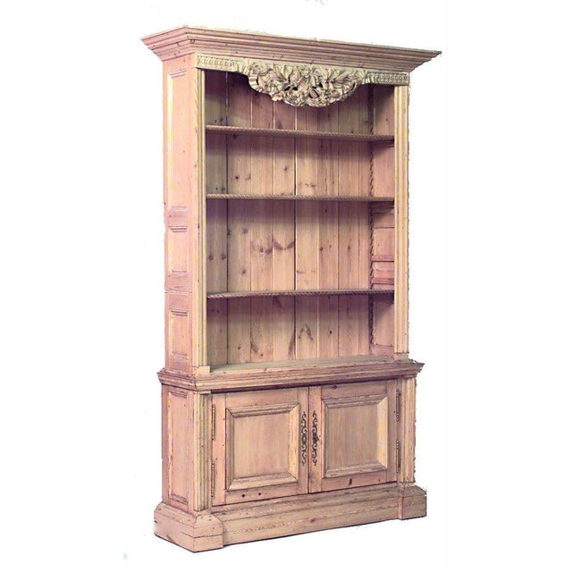 Pair of English country, 19th-20th century stripped pine bookcase cabinets with open shelves and two lower doors with...
