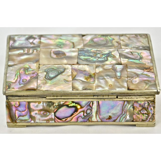 Alpaca silver hinged box inlaid with abalone on top and all four sides and lined with rosewood in vibrant colors including...