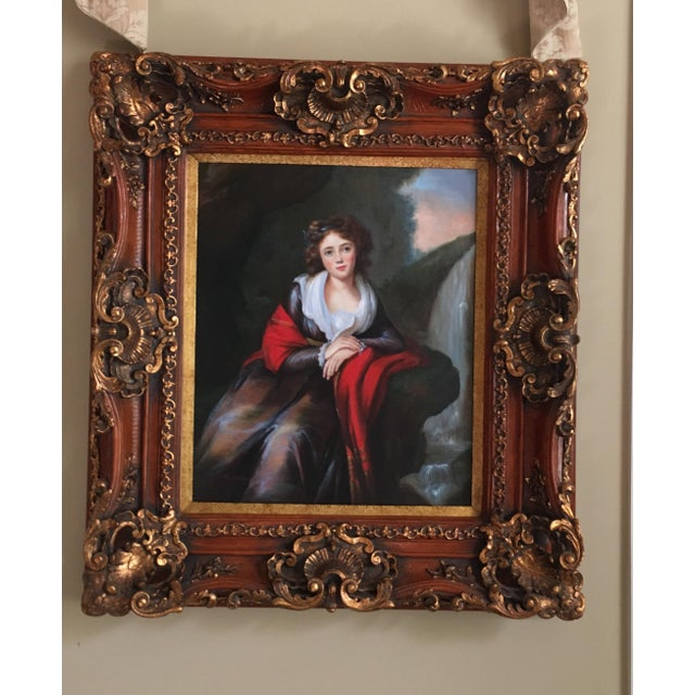 A contessa sitting for portrait. Her grace is captured in the painting with the facial detail. The frame is intricate and...