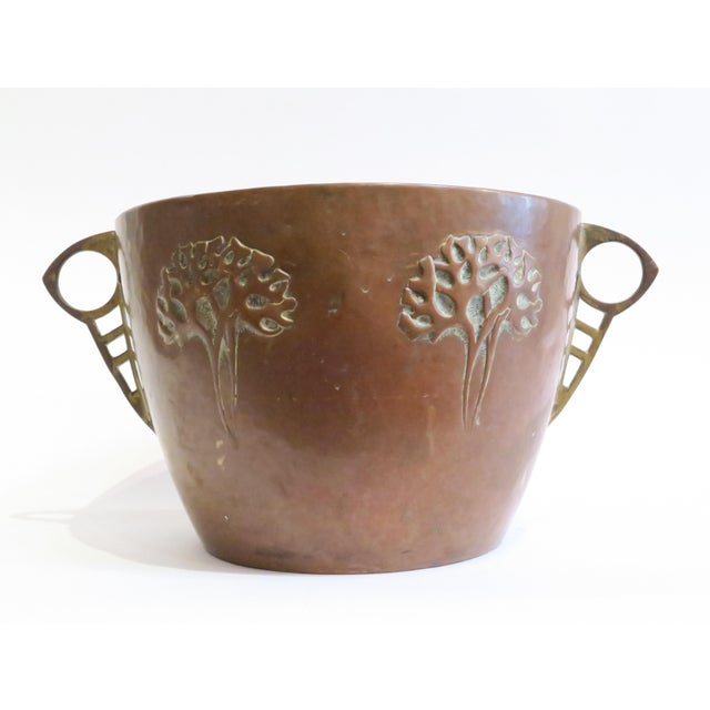 Offered is a unique copper pot with an embossed tree moths. Made with a copper with a beautiful aged patina, and brass...