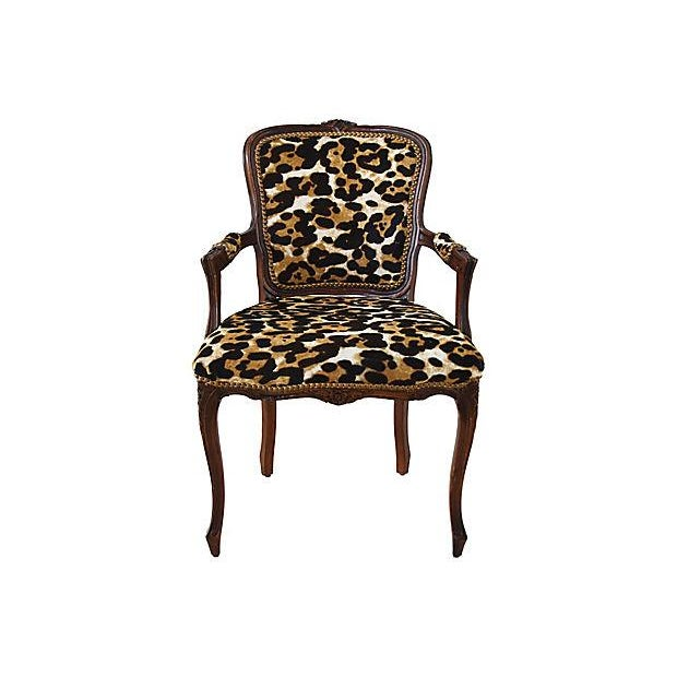 Vintage carved armchair newly upholstered in Italian hair-on-hide/cowhide with a animal spot pattern. Chair is accented...