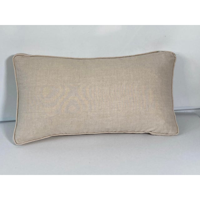 A pillow made from Fortuny's iconic printed cotton in the Sevigne pattern, backed with natural Belgian linen.