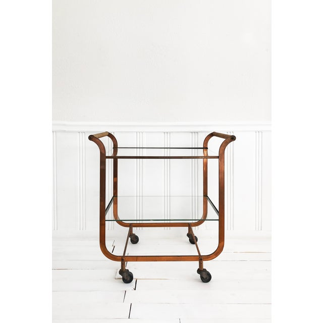 Absolutely stunning art deco, mid century modern copper bar cart with rattan handles by Carl Aubock. Rattan-wrapped...