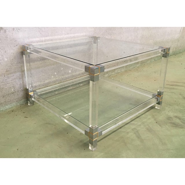 About A square Lucite coffee table with chromed brass details, French, circa 1970 Dimensions big table: H 15.74 in. x W...