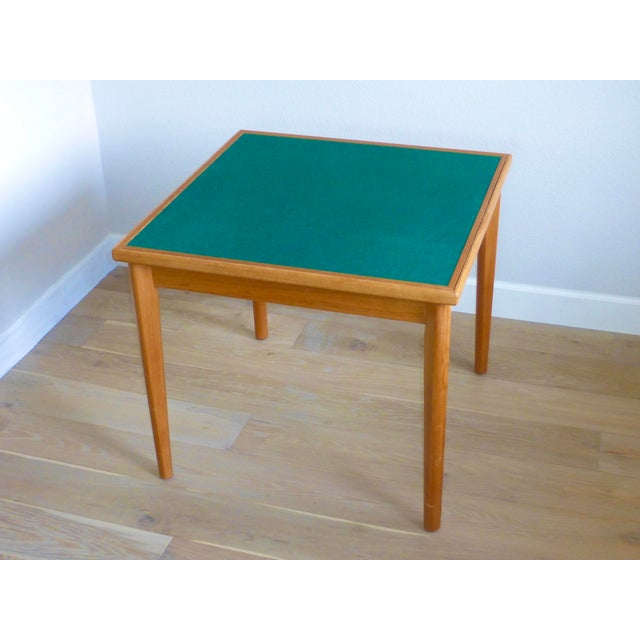 Featuring classic Danish Mid-Century design, this game table is in very good vintage condition. The table is reversible,...