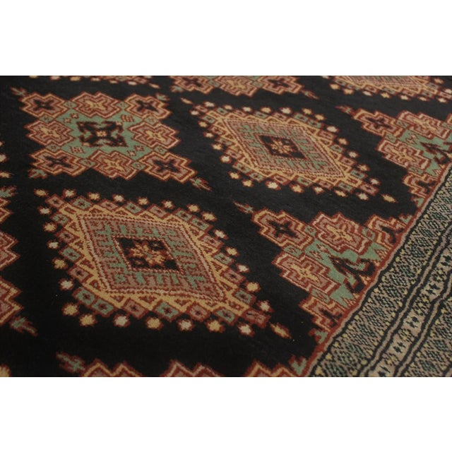 Made with luxurious wool to add comfort and style to your décor, this beautiful Bokara handmade rug features a beautiful...