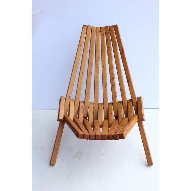 Mid-Century wood folding lounge chair. We have two chairs available.