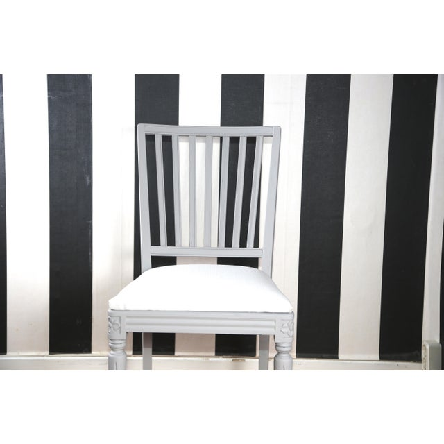 The set of four antique Gustavian-style dining chairs The Gustavian grey paint has been refreshed and the wear is...