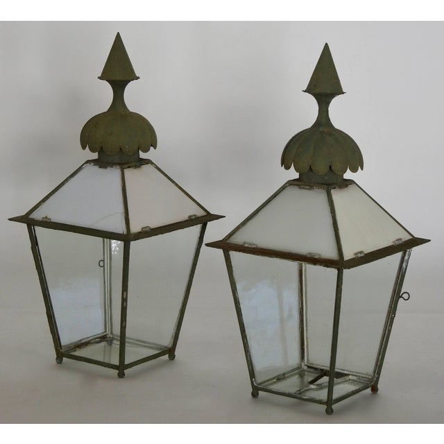 We are offering a set of two Gasolier lanterns from the 1880's. They are made of steel with glass. Superb finials on the...