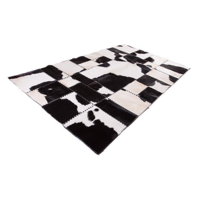 Brand New. This AYDIN Hides Cowhide Patchwork Hair-on-Hide Area Rug has been handmade and stitched with love, passion and...
