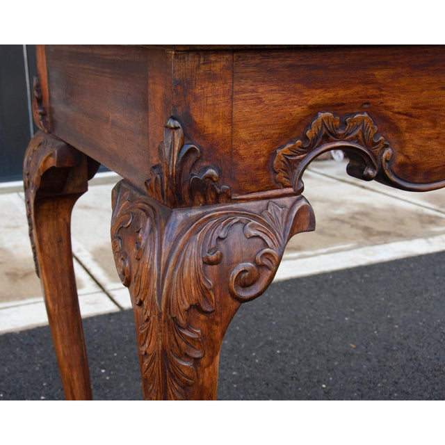"English mahogany flip top console/game table c1900. Beautifully carved with ball and claw feet. Opens to 40"" solid wood top."