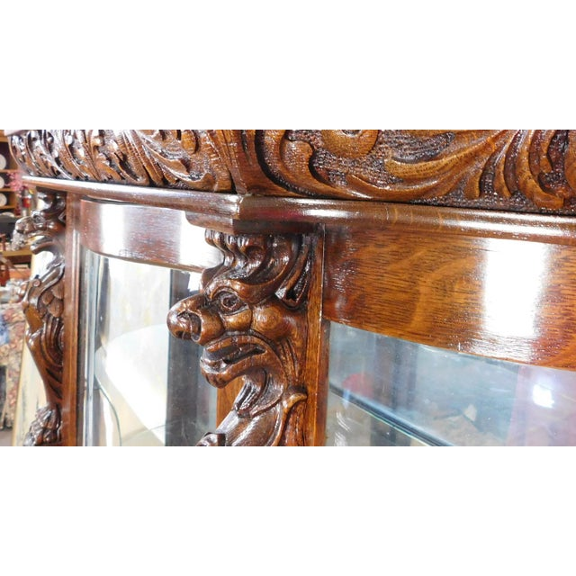 Antique Victorian Carved Figural Quartered Oak Curved Glass Curio Cabinet  c1900 For Sale In New York - Antique Victorian Carved Figural Quartered Oak Curved Glass Curio