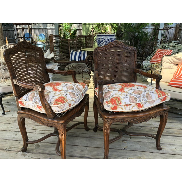 Early pair of French caned chairs. Lovely warm patina, caned seat and back, classic carved details. New Ralph Lauren shell...